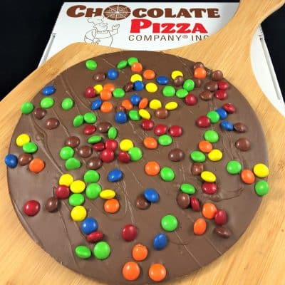 Chocolate Pizza topped with colorful chocolate candy served in a pizza box