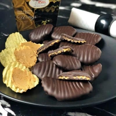 dark peanut butter wings on plate with potato chips