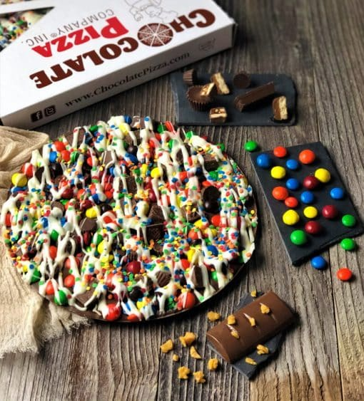 chocolate pizza topped with colorful candy