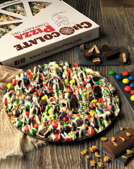 candy avalanche chocolate pizza topped with candies