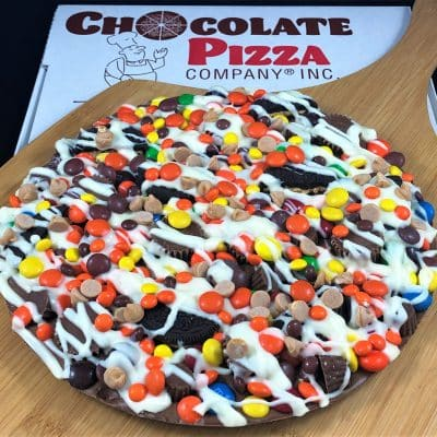 chocolate pizza peanut butter avalanche with peanut butter candies served in a pizza box