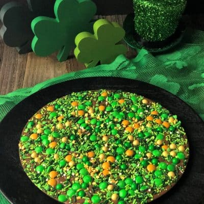 lucky for you chocolate pizza with green gold candy topped chocolate pizza with shamrock table decorations