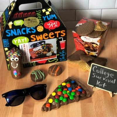 college survival kit with chocolate treats in tote box