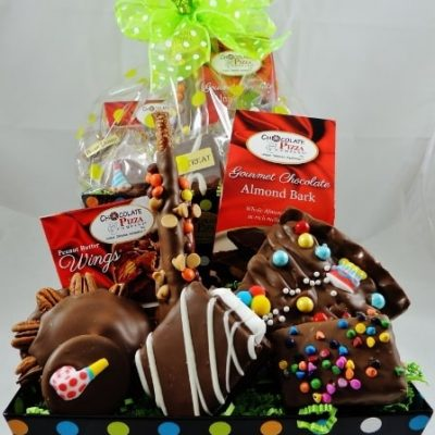 surprise party birthday gift basket with chocolate slice pb wings smore and bow