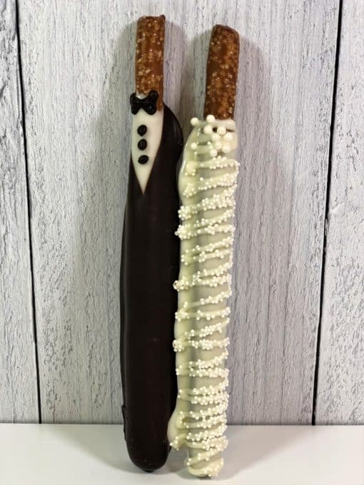 pretzel rods dipped in chocolate and hand decorated for wedding