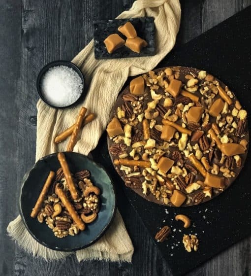 chocolate pizza with caramel, nuts, pretzels