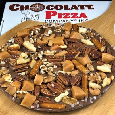 drumstick Chocolate Pizza with pretzels caramel cashews pecans sea salt in a pizza box