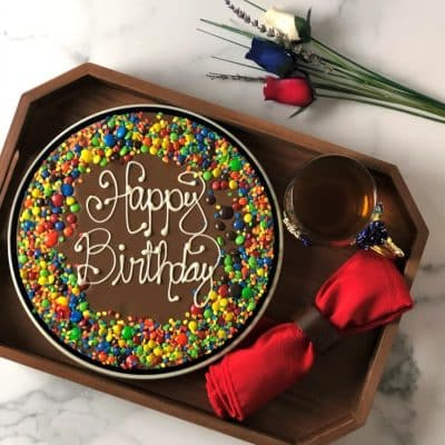happy birthday chocolate pizza on wood tray
