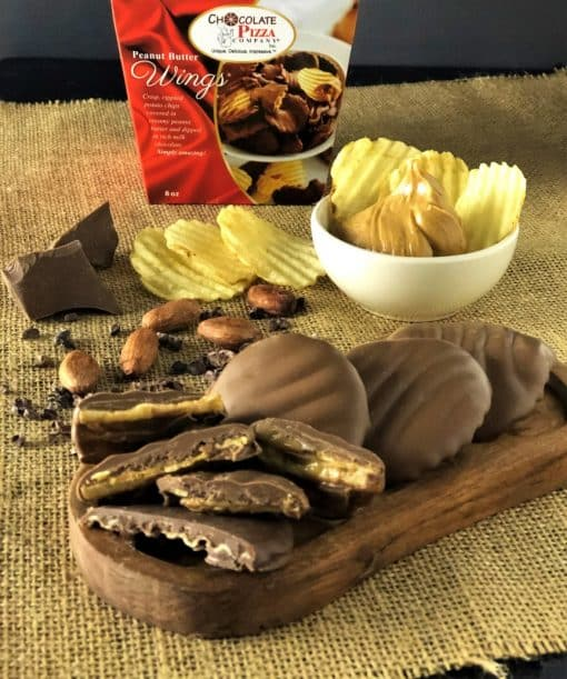peanut butter wings on wooden tray with potato chips and box