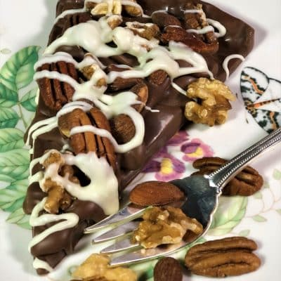 slice chocolate pizza with nuts on plate