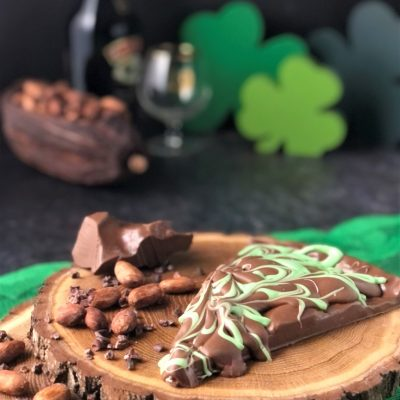 Irish cream slice of chocolate pizza in milk chocolate with green swirls