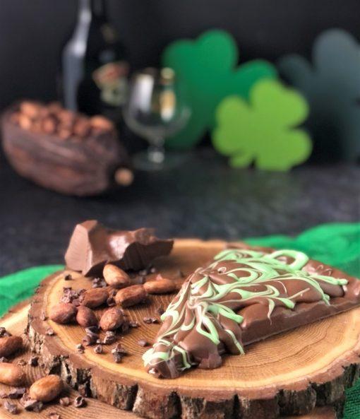 Irish cream slice of chocolate pizza in milk chocolate with green swirls