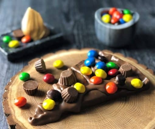 peanut butter candy on Chocolate Pizza slice