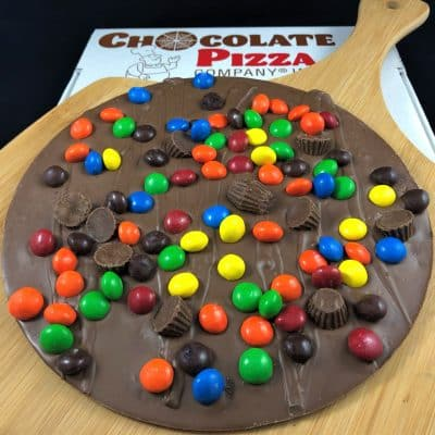 Chocolate Pizza with peanut butter cups and colorful peanut butter candy