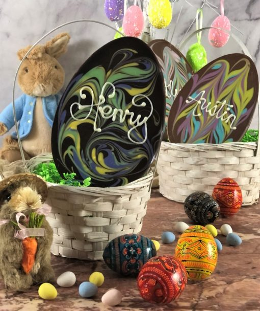 personalized chocolate eggs in dark and milk chocolate with pastel swirls
