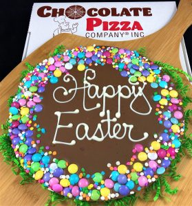 Happy Easter Chocolate Pizza trimmed with pastel candy and sugar confetti
