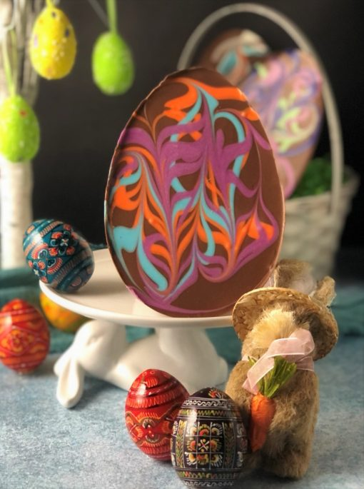 chocolate Easter egg with pastel swirls