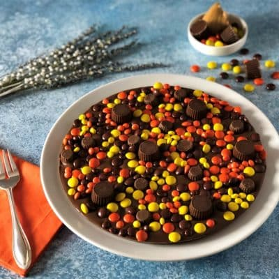 chocolate pizza topped with peanut butter candies and cups