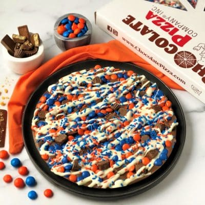 Syracuse chocolate pizza with orange blue candies