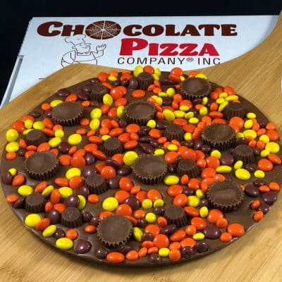 peanut butter blast Chocolate Pizza with peanut butter candy cups in a pizza box