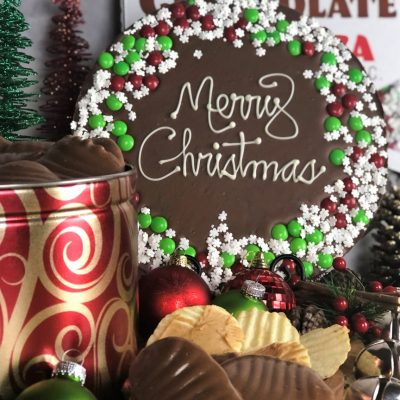 merry Christmas chocolate pizza peanut butter wings in holiday tin