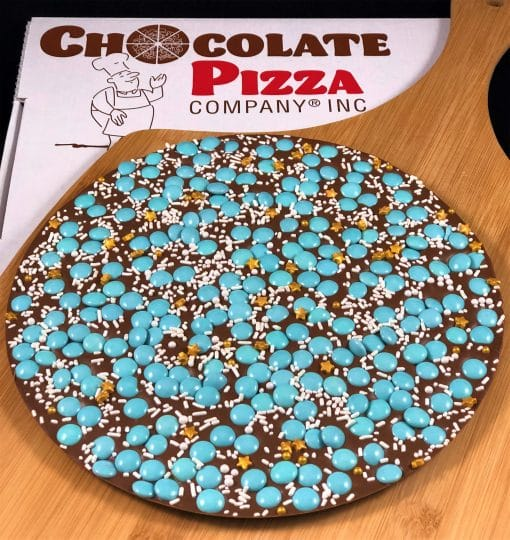 Parkinson's Foundation Chocolate Pizza with teal chocolate candy gold sugar start served in a pizza box