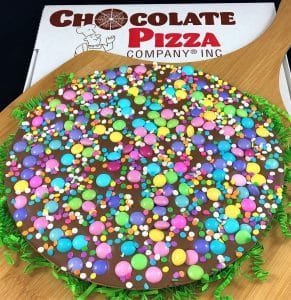celebrate spring chocolate pizza with pastel candy and sugar confetti