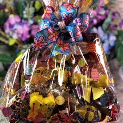 Easter basket with swirled Easter Egg and chocolates