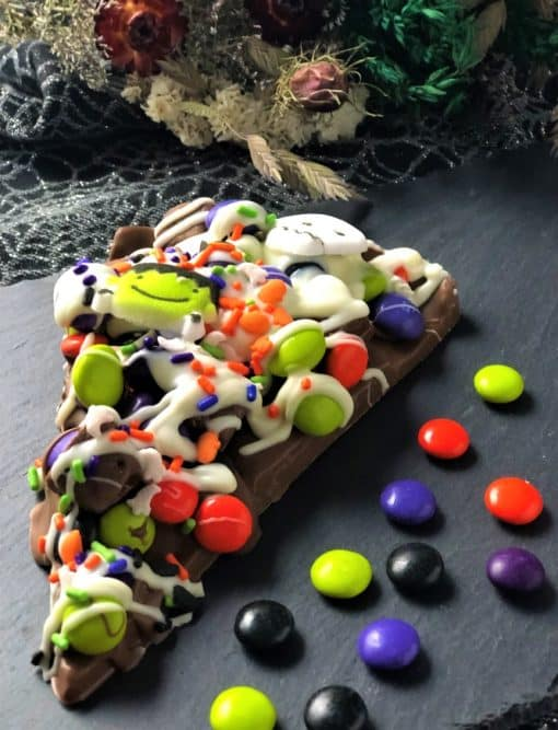 chocolate pizza slice with spooky chocolate decorations