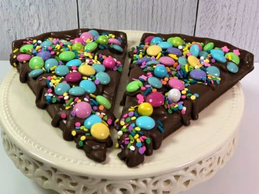 chocolate pizza slices decorated in pastel chocolate candy