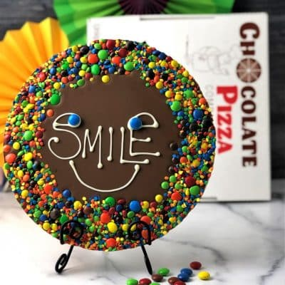 big smile chocolate pizza with colorful candy border