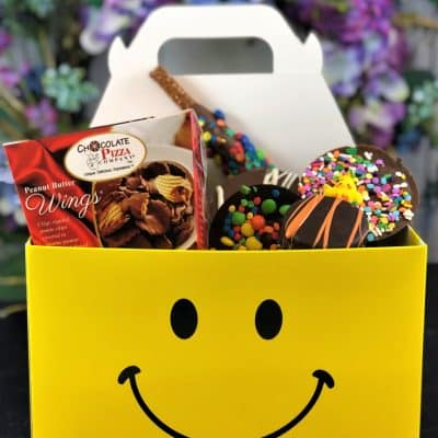 smiles for miles chocolate treats in a yellow smiling face tote box