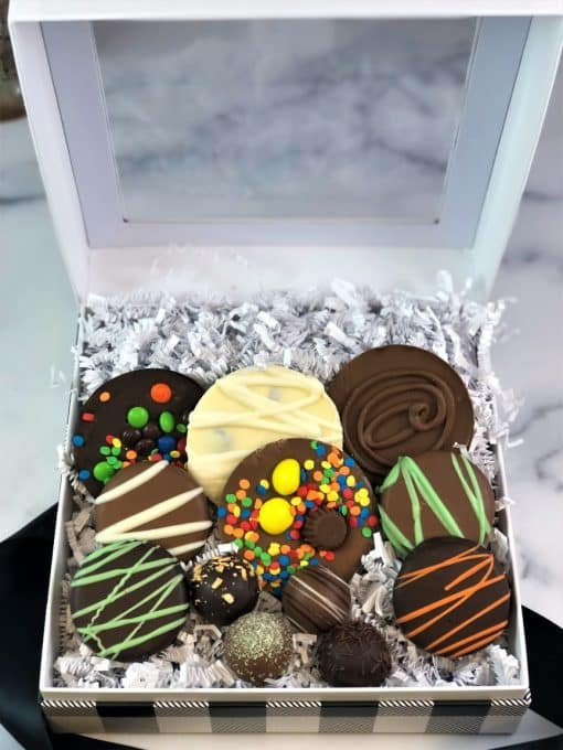 close up of assorted chocolates in a black and white gift box