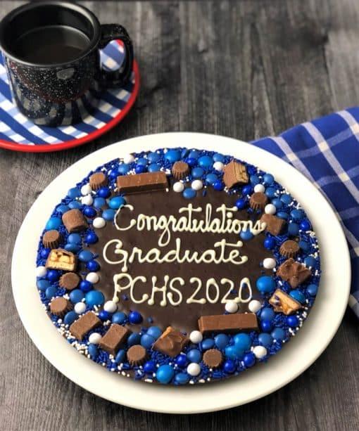 custom graduation chocolate pizza on a plate