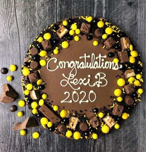 custom graduation chocolate pizza with yellow black candies