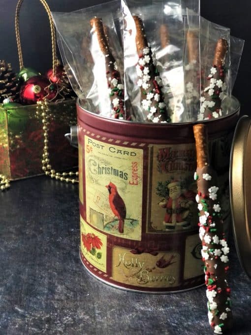chocolate dipped pretzel rods in holiday tin