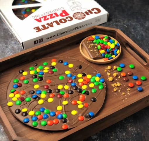 colorful candy topped Chocolate Pizza on a wooden tray