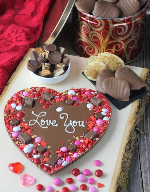 heart shaped chocolate pizza says love you next to peanut butter covered potato chips