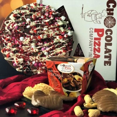 Chocolate Pizza decorated with red candies and box of Peanut Butter Wings is love in every bite
