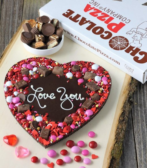dark chocolate heart shaped chocolate pizza with candy peanut butter border