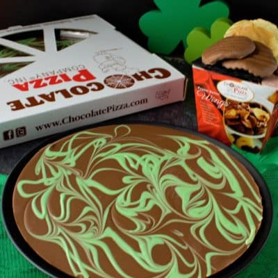 chocolate pizza with green swirls and Irish cream flavor with peanut butter wings box