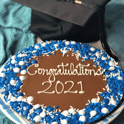 graduation chocolate pizza with blue and white candies