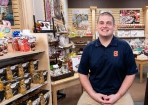 Owner Ryan Novak in Chocolate Pizza Company store